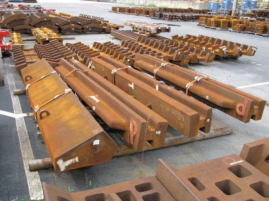 Anvils and breaker bars for scrap metal shredders